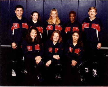 World Champion Tricia Saunders (back center) will participate in the forum on Women in Wrestling.