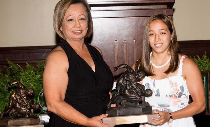 Marina Doi of California receives the first Tricia Saunders High School Excellence Award from her mother Cecilia, during 2014 Honors Weekend in Stillwater, Okla. (Photo by Larry Slater)