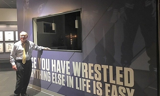 Dan Gable in front of his wall at Hall of Fame for website